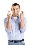 Manen med fingrar korsat royaltyfria bilder