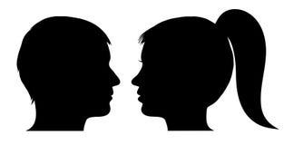 Manen och kvinnan vänder mot profilerar Royaltyfria Bilder