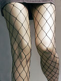 Manequine legs. With net tights and mini skirt royalty free stock image