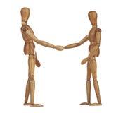Manequins de madeira que agitam as mãos, cooperação do negócio Foto de Stock