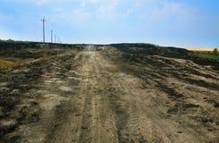 Manera de la arena con la hierba quemada-abajo Imagen de archivo libre de regalías