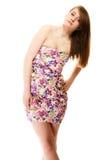 Manera del verano Adolescente en el vestido de flores aislado Imagen de archivo