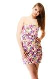Manera del verano Adolescente en el vestido de flores aislado Imagen de archivo libre de regalías