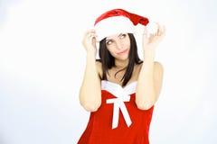 Manera Papá Noel femal que juega con el sombrero Imagenes de archivo