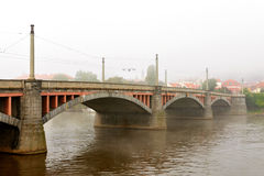 Manes Bridge in fog, Prague Stock Photos