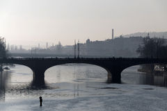 Manes bridge in Prague a foggy morning and a man Stock Photo