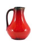 Maneta anaranjada de la jarra de la arcilla aislada en blanco Imagen de archivo