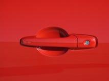 Maneta de puerta roja de coche de deportes Imágenes de archivo libres de regalías