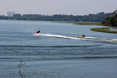 Maneuvers radicals jetski on lake Royalty Free Stock Photo