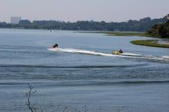 Maneuvers radicals jetski on lake Royalty Free Stock Photo
