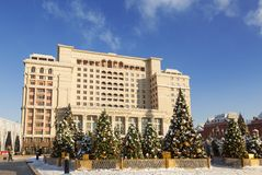 Manezhnaya square decorated with artificial christmas trees on New year and Christmas holidays in Sunny day, Moscow stock photos