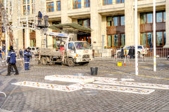 Manezhnaya Square. Installation of Christmas decorations. MOSCOW, RUSSIA - November 20.2016: Manezhnaya Square. Brigade of fitters sets new-year decorations on a stock photos