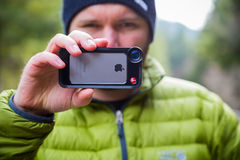 Manfrotto iPhone Lens Photographer Royalty Free Stock Images