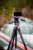Manfrotto KLYP+ Lens and Tripod System for iPhone. Oakridge, Oregon, USA - February 19,2014: Manfrotto KLYP+ lens system and tripod mount connected to an iPhone royalty free stock image