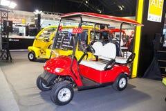 A MANGÉ la voiture de golf Images libres de droits