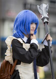 Manga girl with a scythe and blue hair Royalty Free Stock Image