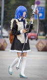 Manga girl with a scythe and blue hair Stock Photos