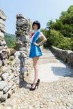 Manga Schoolgirl. Beautiful model posing in black wig, as a manga japanese schoolgirl Stock Photography