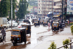 Traffic in Mangalore. Mangalore, India - September 3, 2012: The traffic on the streets of Mangalore is a big mess. Taxis, mopeds and pedestrians cross without royalty free stock photo