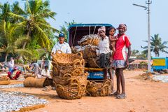 Mangalore people. Mangalore, India - February 10, 2016: Group of people pose near baskets with dried fish. Mangalore is the biggest city of the Tulunad Tulu Nadu Royalty Free Stock Photography