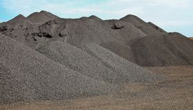 Large piles of processed Manganese rich ore rock stock photography