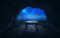 Manger in cave. An empty manger inside a cave under the star of Bethlehem Royalty Free Stock Photos