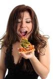 Manger de la pizza Photos stock