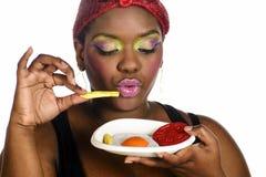 Manger des aliments de préparation rapide Images libres de droits