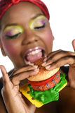 Manger des aliments de préparation rapide Photos libres de droits