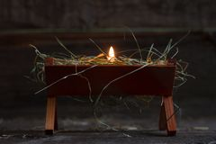 Manger Jesus and light of hope abstract christmas symbol. Closeup Stock Image