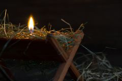 Manger Jesus and light of hope abstract christmas symbol. Closeup Royalty Free Stock Photography