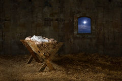 Manger in Old Barn with window Stock Images