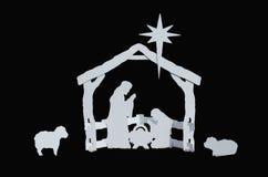 Manger Silhouette Baby Jesus Mary Joseph Lambs. White Manger silhouette on black background Stock Photo