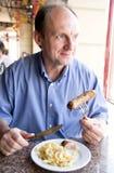 Mangeur d'hommes âgé heureux Photographie stock
