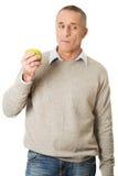 Mangeur d'hommes mûr une pomme Photo stock