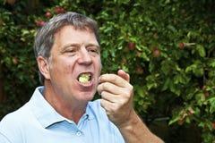 Mangeur d'hommes une pomme Images libres de droits