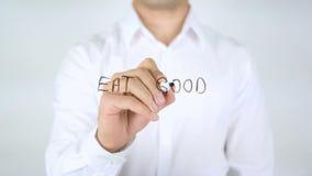 Mangez la bonne sensation bonne, écriture d'homme sur le verre banque de vidéos