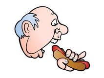 Mangi il hot dog squisito Fotografie Stock