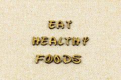 Mangi il tipo fresco organico dello scritto tipografico di alimento di salute sana di dieta fotografie stock