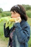 mangia la ragazza Immagine Stock