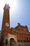 Mangia's tower. Torre del Mangia and Palazzo Pubblico in Siena Stock Image
