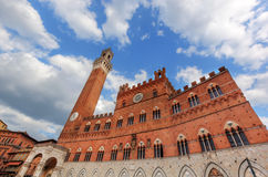 Mangia Tower, Italian Torre del Mangia in Siena, Italy - Tuscany region Stock Photography