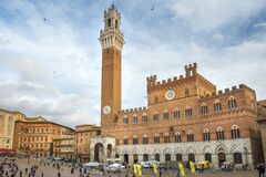 Mangia Tower and Palazzo Pubblico Town Hall at the Piazza del Campo, Siena, Italy