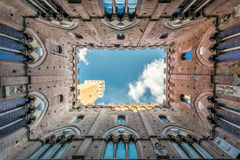Mangia Tower (Sienna, Italy). The secular Mangia Tower (constructed in 1338-1348) was built to be exactly the same height as the Siena Cathedral as a sign that Stock Image
