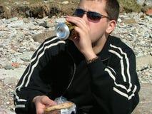 Mangiando nella spiaggia Fotografia Stock Libera da Diritti