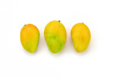 Mango. A row of mango on a white background Stock Photos