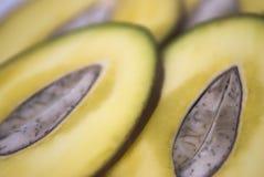 Mango. Sliced tropical fruit on white background , mango Stock Photography