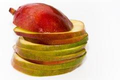Mango. Sliced tropical fruit on white background , mango Royalty Free Stock Image