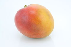 Mango. A whole mango fruit on white Royalty Free Stock Photos