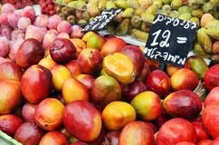 Mango And Plums On Market Stand Royalty Free Stock Image
